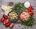 Ingredients for cooking mussels shrimp on a wooden cutting board wooden background top view Royalty Free Stock Photo