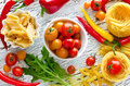 Ingredients for cooking pasta and vegetables red yellow green Royalty Free Stock Photo