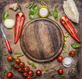Ingredients for cooking vegetarian food bell peppers, knife for vegetables, cherry tomatoes branch and seasoning herbs place Royalty Free Stock Photo