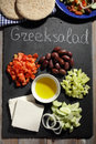 Ingredients for Greek salad on a slate cutting board Royalty Free Stock Photo