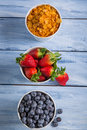 Ingredients for a healthy breakfast with fruits on old wooden table Royalty Free Stock Images