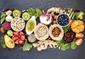 Ingredients for the healthy foods selection. The concept of healthy food set up on dark stone background Royalty Free Stock Photo