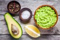 Ingredients for homemade guacamole: avocado, lemon, salt and pepper Royalty Free Stock Photo