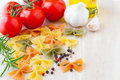 Ingredients for Italian cuisine: farfalle pasta, tomatoes, olive Royalty Free Stock Images