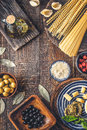 Ingredients of Italian cuisine on the wooden table vertical Royalty Free Stock Photo