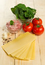 Ingredients for lasagna on a wooden table Royalty Free Stock Photos