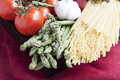 Ingredients linguini dinner asparagus tomatoes Royalty Free Stock Image