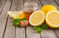 Ingredients for making lemonade - lemon, mint and honey Royalty Free Stock Photo