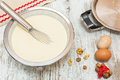 Ingredients for making pancake batter ready pancakes on wooden table viewed from above Royalty Free Stock Photos