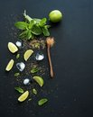 Ingredients for mojito fresh mint limes ice sugar over black backdrop top view copy space Royalty Free Stock Images