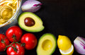 Ingredients for sauce guacamole on black stone background Royalty Free Stock Photo