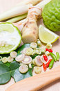Ingredients for thai spicy food such as kaffir lime fruit and leaves lemon chili galangal oil and lemon grass Royalty Free Stock Photo