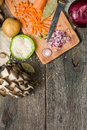 ingredients for vegetable soup. vegetables cucumber onions potatoes carrots mushrooms Royalty Free Stock Photo
