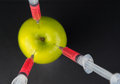 Injection into an apple Royalty Free Stock Photo