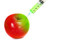 Injection green into red fresh wet apple with syringe on white background for renew energy , therapy or refresh or boost up energy