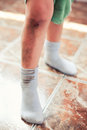 Injured child with scratch on his leg after falling on ground Stock Photo