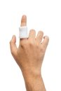 Injured finger wrap in white bandage isolated Royalty Free Stock Image