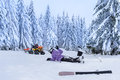 Rescue ski patrol help injured woman skier