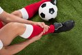 Injured soccer player close up of on field Royalty Free Stock Photo