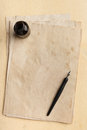 Ink pen, inkpot and old paper Royalty Free Stock Photo