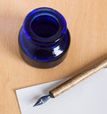 Ink-stand and pen Royalty Free Stock Image