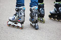 Inline skating picture of the feet of two teenagers with skaters Stock Photos