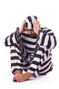 Inmate in stiped uniform on white Stock Images