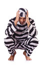 Inmate in stiped uniform on white Royalty Free Stock Images
