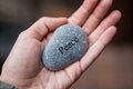 Inner balance concept: hands holding stones with the word peace Royalty Free Stock Photo