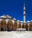 The inner courtyard of suleymaniye mosque istanbul surrounded by arched gallery with ablutions fountain in center turkey Royalty Free Stock Photo