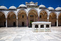 The inner courtyard of suleymaniye mosque istanbul surrounded by arched gallery with ablutions fountain in center turkey Royalty Free Stock Image
