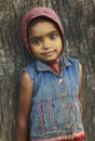 Innocence rural girl little standing near tree Royalty Free Stock Photography