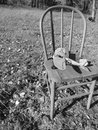Innocence a toy plane on a simple chair i can across these two items in the middle of a wooded area it represents the of a child Royalty Free Stock Photography
