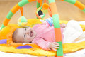 Innocent baby smiling and playing with toys Stock Image