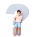 Innocent girl with a big question mark sign Royalty Free Stock Photography
