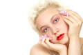 Innocent girl blond holding plucked flowers face closeup with copy space Stock Photos