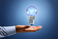 Innovation businessman with illuminated light bulb concept for idea and inspiration Royalty Free Stock Image