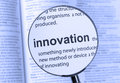 Innovation highlighting thru a magnifying glass Stock Photography