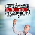 Businessman drawing innovation word cloud concept Royalty Free Stock Photo