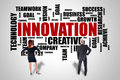 Innovation word cloud concept watched by business people Royalty Free Stock Photo