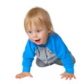 Inquisitive child crawling on the floor isolated white background Royalty Free Stock Photography