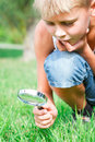 Inquisitive teenager with a lens in the park Stock Image