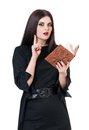 Inquisitive witch with book for spells isolated on a white background Stock Photography