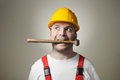 Insane young worker crazy handyman with hammer Stock Photography