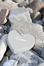 Inscribed love heart on the rocks single grey wooden a pebble beach in ireland Royalty Free Stock Photos
