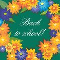 Inscription back to school on background of green chalkboards and flowers.