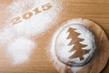 Inscription 2015 on flour and Dough patterned Christmas treeon a Royalty Free Stock Photo