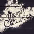 The inscription Merry Christmas , written with flour on a dark wooden background. Christmas greeting card. Royalty Free Stock Photo