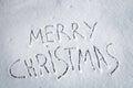 Inscription Merry Christmas written on snow