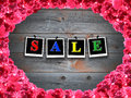 Inscription sale and frame from roses red on the background of boards Stock Images